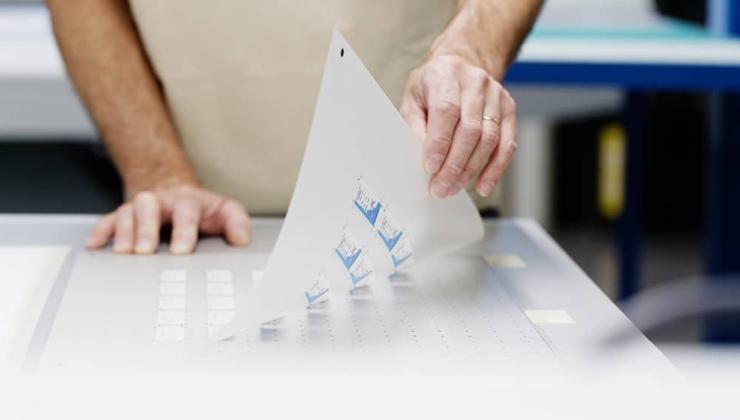 Impression quadrichromie + blanc sur film en polycarbonate